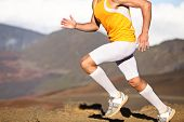 Running sport fitness man. Closeup of strong legs and shoes in action. Male athlete fitness runner s