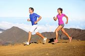 Running sport - Runners couple in trail run outside in amazing nature. Fit young sports multiracial