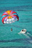 stock photo of parasailing  - parasailing over the Caribbean ocean taken in nassau bahamas - JPG