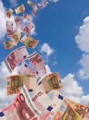 A Lot Of Flyinq Away Banknote On  A Sky Background