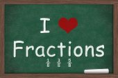 foto of fraction  - I love Fractions I heart fractions with examples written on a chalkboard with a piece of white chalk - JPG