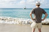 Man Standing on a Caribbean Beach