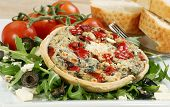 pic of tarts  - vegetarian cheese and red pepper tart with rocket olives and vine tomatoes - JPG