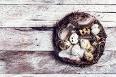 Easter Basket With Easter Eggs On Wooden Background. Quail Easter Eggs In A Nest On  Wooden Table Wi