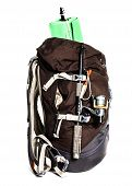 Large Touristic Backpack With Lightweight Foam Mat And Fishing Rod Isolated On White Background.