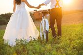 stock photo of wedding  - Beautiful bride and groom wedding portrait with white bike - JPG