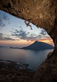 Male rock climber at sunset. Kalymnos, Greece