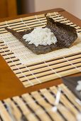Nori seaweed sheet with rice above to make sushi