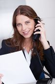 Businesswoman Talking On A Telephone