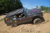 Black Offroad Car In The Rough Terrain