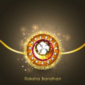 Beautiful rakhi on shiny brown background for the festival of Raksha Bandhan celebrations.