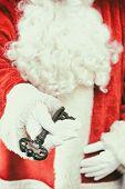 Santa Claus holding the key to Christmas