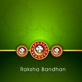 Beautiful rakhi with golden color thread on floral decorated green background for the festival of Ra