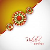 Beautiful rakhi on grey and brown background on the occasion of Happy Raksha Bandhan festival.