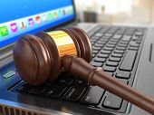 Online internet auction. Gavel on laptop.  3d