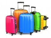 Luggage. Colorful suitcases on white isolated background. 3d