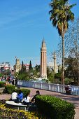 ANTALYA, TURKEY - MARCH 26, 2014: People resting in the park against Yivli minaret. Built in XIV cen