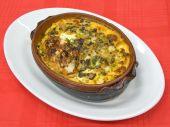 Lasagna in clay bowl