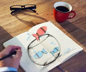 Man Drawing Fishes on a Fish bowl