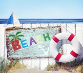 White Fence and Beach Signboard