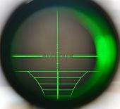 stock photo of snipe  - Snipe scope telescope close up with green light - JPG