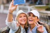 beautiful tourists taking a selfie with smart phone camera