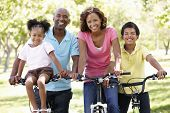 Family cycling in park