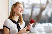 Young attractive lady having date at cafe