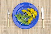 fresh dandelion flowers in plate
