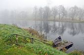 Autumn Mist And Boat In River