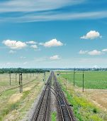two railroad to horizon and blue sky