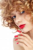 Close-up portrait of young beautiful woman with stylish manicure and red lipstick over white backgro