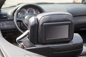 Multimedia backseat screen in a luxury car