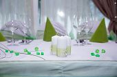 Decoration on wedding table, candles and decorations