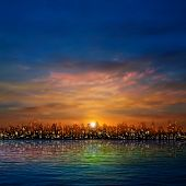 Abstract Nature Background With Panorama Of City Clouds And Sunset