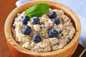 detail of natural oatmeal mixed with fresh blueberries