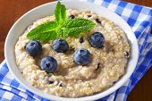 portion of oatmeal with fresh blueberries