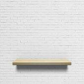 Wooden shelf on a white brick wall