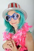 A Young Woman With Blue Hair gets ready for the Big 4th of July Celebration by wearing the colors of