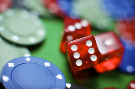 picture of gambler  - casino chips and dices stacking on a green felt - JPG