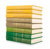 Stack Of Vintage Book In A Green And Yellow Cover On A White Background