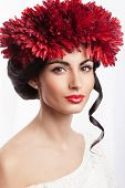 Beauty Shot Of Adorable Woman In Wreath Of Red Flowers