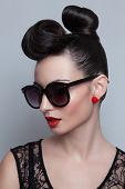 Fashionable Model In Trendy Sunglasses. Plastic Skin. Portraiture. Red Lips. Updo, Twisted High Bun.
