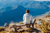 Man Sitting On Bench, High Up In The Mountains Enjoying Beauty World, Looking From Lovcen Mountain I