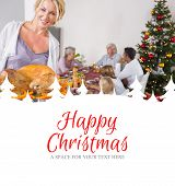 Proud mother showing roast turkey against happy christmas