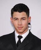 LOS ANGELES - NOV 23:  Nick Jonas arrives to the 2014 American Music Awards on November 23, 2014 in Los Angeles, CA