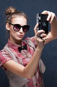 Portrait Of Trendy Girl Shooting Autoportrait With Retro Camera. Taking The Selfie