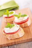 bread with tomato, mozzarella and basil