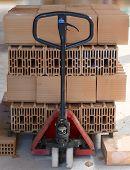 Hand pallet truck with bricks poroton