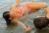 Teenage Girls Playing In The Sea
